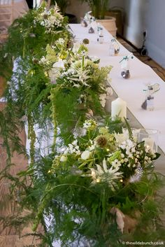 A long top table design by top Bristol florists The Wilde Bunch at The Matara Centre in the Cotswolds. Based on three of our Scandinavian kiln dried natural tree roots. The flowers and ferns are 'planted' into the roots and lightly illuminated to show off the contorted root base. Wedding Bouquets, Wedding Flowers, Tree Roots, Florists, Centre Pieces, Ferns, Bristol, Greenery, Scandinavian