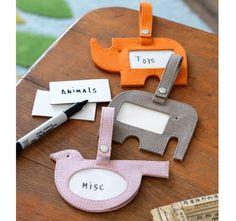 Animal ID tags. Good way to organize play room bins.