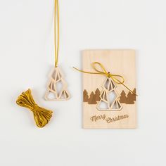 """Surprise your family and friends with a laser etched card and ornament in one!  Set Includes: 6 wood cards with removable ornaments, easily secured with gold elastic. (Envelopes are not included).  Size: 4"""" x 6"""" x 1/8"""""""