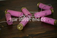 Guns and glitter... pistols and pearls... pink and gold baby shower