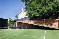 Architecture firm Molecule used The Dark Knight as inspiration in adding a basement garage to a 1929 house. The old house's modern garage is accessible through a secret entrance that lifts up from part of the adjacent tennis court Hidden Passageways, Underground Garage, Underground Shelter, Underground Homes, Melbourne Suburbs, Cabinet D Architecture, Ultimate Garage, Hidden Rooms, Hidden Spaces
