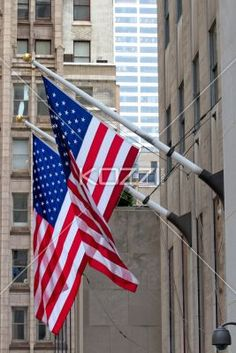 american flag outside building. - View of American flag outside building.