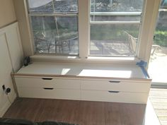 window-seat-ikea-hack-progress from closet organizer drawers to built in window seat!