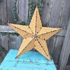 A personal favorite from my Etsy shop https://www.etsy.com/listing/489096281/vintage-rusty-metal-star-industrial-star