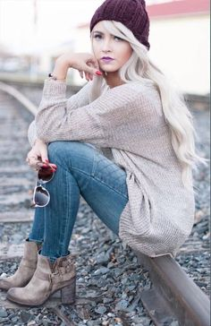 Taupe sweater and booties with blue jeans and cute burgundy hat.