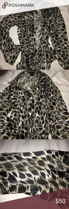 ESACADA $1,000 FINE SILK SPUN BLACK/WHITE LEOPARD ABBBBSOLUTELY STUNNING FINE SPUN SILK!! ESCADA signature stamped buttons!! YES!! Yes!! RETAILED FOR A GRAND!! No SH&)&$&T!! Gorgeous ! And this is REALLLY RARE!!! RARE!! And especially for THE PRICE!! 🎶🎶🎶💃🏽💃🏽💃🏽🎉 Escada Tops Button Down Shirts
