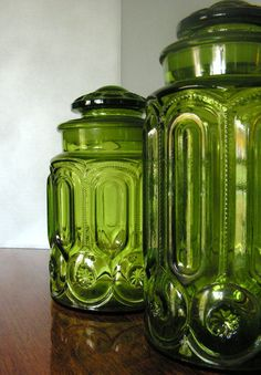 Vintage Green Glass Jars kitchen cannisters by hurstdesigns. I have these in red--a wedding present from my parents 1970 Vintage Dishes, Vintage Glassware, Vintage China, Bottles And Jars, Glass Jars, Vases, Vintage Green Glass, Antique Chandelier, Glass Kitchen