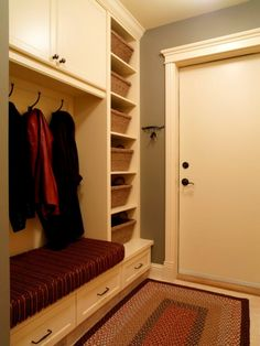 Dramatic mudroom design for small space with spooky lighting concept along with compact rattan containers