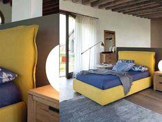 Camas tapizadas con canapé. Mesitas en roble macizo; consigue un estilo rústico original.