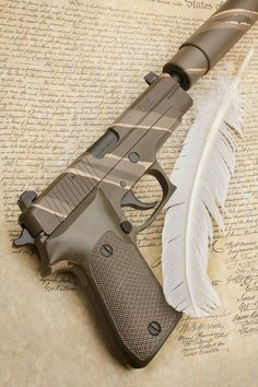 Sig 220.  love this! Being a woman I need a smaller grip for my hands ;) Who needs a Silencer I want them to hear me before they die! I say die because I was taught when you pull a gun you shoot to kill!  ITS NOT A GAME.