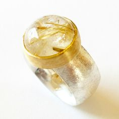 Silver and 22 karat gold ring with Rutilated quartz. www.heleenhoogenboom.com