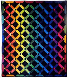 = free pattern = Rainbow Twist quilt by Laurie Shifrin for In The Beginning Fabrics, Spring 2015.  Featured at Modern Quilts Unlimited.