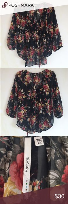 Bellateix Black Floral Print Blouse, XS This romantic Bellateix Black Floral Print Blouse, XS can be worn anywhere! To the office, out with friends and even in a date! EXCELLENT CONDITION, NO DEFECTS AND COMES FROM A SMOKE FREE HOME. Bellatrix Tops Blouses