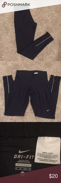 Women's Nike dri-fit running tights XS Excellent condition women's black Nike Dri-Fit running tights. Size XS. Has zippers at the ankle and a zippered back pocket. Nike Pants Leggings