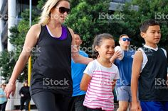 Family Friends walking in Urban Scene royalty-free stock photo