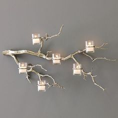 natural tree branch painted with gold lacquer, glass containers and candles