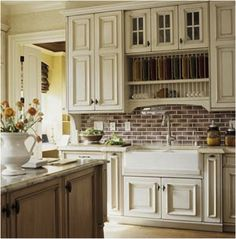 brick with white mortar enhances the update country feel with the apron double sink