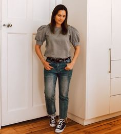Puff sleeve ribbed top, straight leg jeans and sneakers | For more style inspiration visit 40plusstyle.com