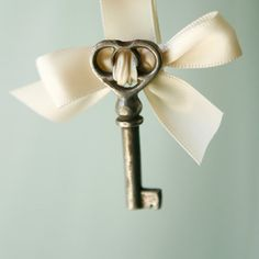 The groom wears a key boutonniere and the bride has the lock to it on her bouquet.