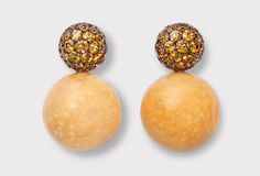 Hemmerle earrings featuring melo pearls, orange sapphires, pink gold and copper (2011)