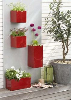 Decorating Small long Front Porch - Bing Images. Love these box planters. thought about doing the same thing but with birdhouses since plants won't survive on our front porch.