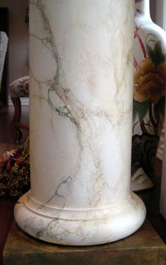 I'm having a really difficult time finding the right marble pillar but this will have to do.