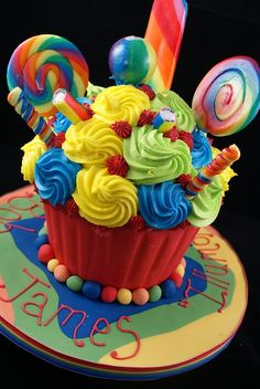 I Love this! So, so colorful and good for a boy or girl!Epicurean Mommy: Giant Cupcakes Ideas #giantcupcake #birthday #cake