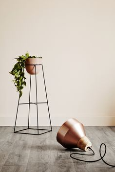 From the Nightshade Collection by Ivy Muse.  Beautiful, functional plant stands that allow you to get creative with your  greenery.  Designed and made in Melbourne from 6mm powder coated steel.  Available in white and blush clay*. *limited edition colour available while stocks last  The Empire is suited to a wide range of botanical vessels including smaller  pots, vases and plant bags. It also features a lower cross bar which can  house another plant or can be used as a display shelf for…