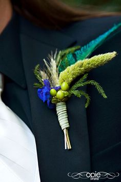 True blue, green and turquoise - I like this boutonniere a lot, the colored plants and the green berries - MP