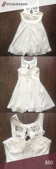 Xenia Boutique White dress Super cute white dress from Xenia Boutique, size :10 fits like a medium/large, great condition, no flaws, new without tags, bundle to save $$ Xenia Boutique Dresses