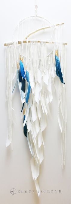 Atlantis in Snow Quartz White with White Feathers, Hand Painted Blue Feathers and Hand Painted Gold Quills