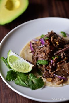 Barbacoa - This is so easy to to make in your slow cooker for a tender, delicious beef barbacoa recipe that rivals that Chipotle favorite! So simple and full of flavor! //addapinch.com