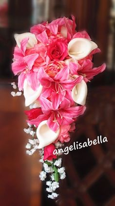 Pink Lily bouquet with cascading flowers! I like the addition of the peonies and roses.