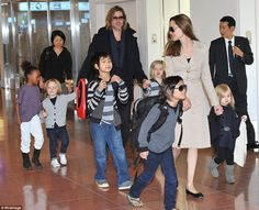 A little airport style how-to, courtesy of the Jolie-Pitts