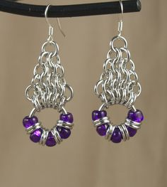 Bright aluminum earrings in the chain maille weave European 4-1 with a wreath-style drop. Pairs nicely with the Wreath bracelet.  Available in a wide range of colors.  Shown here in Dark Lilac, Cranberry, St.