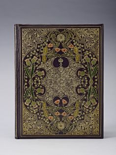 Queen Alexandra's Christmas Gift Book, 1908, a leather-bound book inside a burgundy velvet cover; on the cover are gold-tooled thistles, roses and shamrocks, symbols of Scotland, England and Ireland. (Royal Collection Trust/ © Her Majesty Queen Elizabeth II 2014)