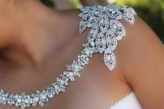 Statement piece of the moment right on trend. If you are looking for that something beautiful for your wedding day you have found it the perfect statement shoulder necklace. This stunning shoulder necklace drapes dramatically around your shoulder so beautiful. If you are looking for