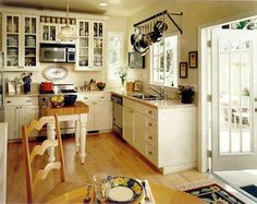 pot rack mounted against the wall (mediterranean kitchen by Andre Rothblatt Architecture) Kitchen Sink Window, Kitchen Cupboards, Pot Rack Hanging, Hanging Pots, Cottage Style Decor, Cottage Decorating, Decorating Ideas, Decor Ideas, Room Ideas
