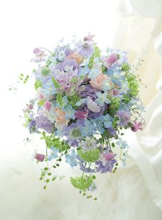 シャワーブーケと花冠 ヨコハマ グランド インターコンチネンタルホテル様へ 水色のドレスに : 一会 ウエディングの花