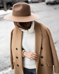 Pair a camel overcoat with a camel hat.