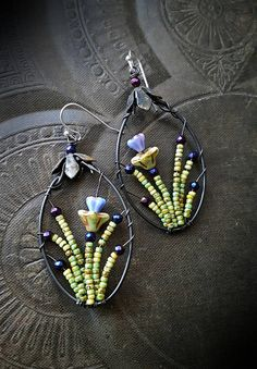100 % Artisan Made; wire wrapped glass flowers with faceted rounds of Hematite, all forms a bursting delicate garden, finished off with sterling silver ear wires • very light weight!!!!!!!!!!!!!! • never to be duplicated exactly • totally unique • 100% ARTISAN HANDMADE!! • Yucca Bloom original ◄The, Blossom Series, is EXCLUSIVE TO/AND ORIGINAL WORKS OF YUCCA BLOOM FINE ARTISAN JEWELRY►