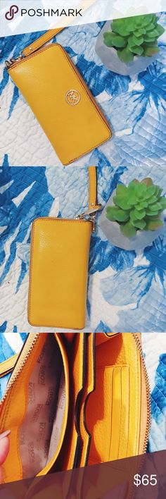 Michael Kors Large Leather Wristlet  Yellow Michael Kors wristlet. In great condition! I normally used this as a clutch during a night out for a pop of color. 3 inside card slots. Plenty of room for cash. Slight scratches on MK symbol (see photos).  Michael Kors Bags Clutches & Wristlets
