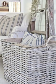 Gorgeous cane baskets and striped cushions..