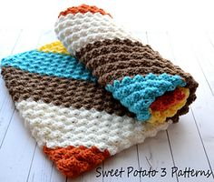 """This crochet pattern comes with complete instructions for the Modern looking baby blanket called, Diagonal Delights! The Diagonal Delights Design is a wide striped corner to corner blanket. If you haven't made a corner to corner blanket you are in for a treat. They work up quick and are fun to see come together. The blanket measures 30""""X 30"""" square and is ideal for laying the baby on or cover a car seat, etc. The blanket has a lovely texture to it. {The increase rows of the blanket will…"""