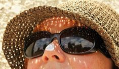 Take Care From The Sun - Lindos Beach In Rhodes Greece