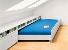 This is genius! Perfect for a guest bedroom in the attic. Use the space for your own stuff (workout equipment, space to do jigsaws) then pull the bed out when you have guests. - My Interior Design Ideas Attic Renovation, Attic Remodel, Loft Room, Bedroom Loft, Eaves Bedroom, Dormer Bedroom, Attic Bedroom Storage, Mezzanine Bedroom, Attic Spaces