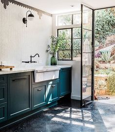 Yet another reason to love @candiscayne 's sunny kitchen- this incredible door out to the backyard. @gambleplusdesign did an incredible job with the reno and @echoandearl took such great photos. Be sure to catch the full home tour (and Candis' sweet boxers, Samson and Delilah) at DS today. Link in profile above ☝🏽