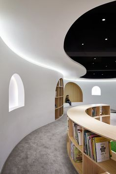 Curving wood-lined nooks create private reading pockets in Shanghai children's library Kids Library, Library Design, Shanghai, Beijing, Commercial Design, Commercial Interiors, Kindergarten Design, Curved Walls, Kid Furniture