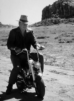 """Okay, who stole the reins?"" John Wayne Riding A Motorcycle On Location For Big Jake 1971"