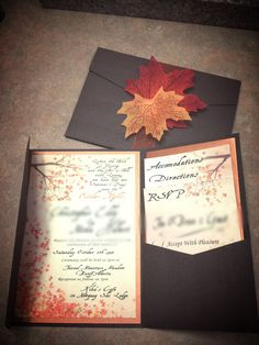 Autumn wedding invites.  Pocket fold invites from cardsandpockets.com   The card is wood grained with maple leaves and forest themed
